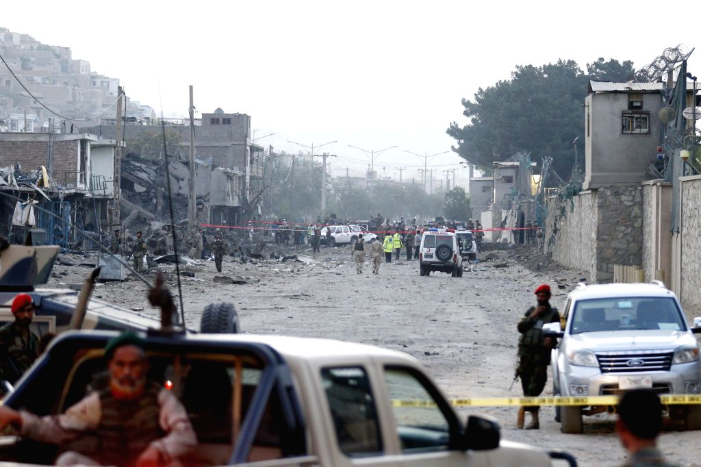 People gather at the site of a blast in Kabul, capital of Afghanistan, Aug. 7, 2015. At least eight civilians were killed while nearly 400 others wounded in a truck ...