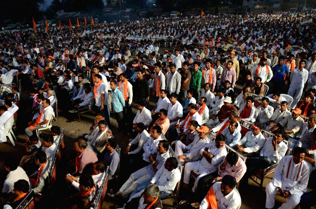 People gather during an election campaign for Mahayuti candidate from Ramtek Lok Sabha constituency, Krupal Tumane (of Shiv Sena) in Kanher of Maharashtra on April 7, 2014. Mahayuti consists of BJP, Shiv Sena, Republican Party of India (RPI –A), Ra