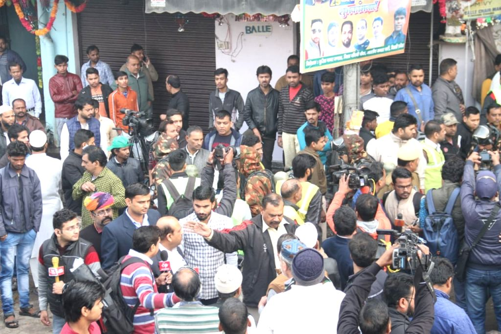 People gather outside factory area in the Anaj Mandi area of Delhi's Rani Jhansi Road area where fire broke out, in Delhi on Dec 8, 2019. Reportedly 43 people were killed and over a dozen ...