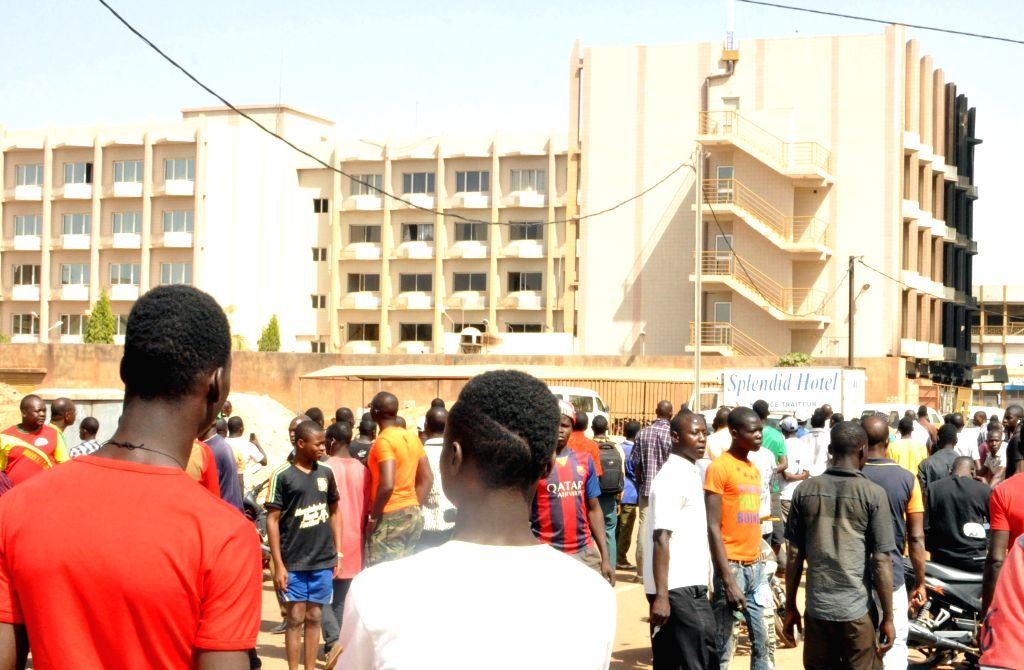 People gather outside the Splendid Hotel in Burkina Faso's capital Ouagadougou, Jan. 16, 2015. Twenty-three people have been killed and many others wounded ...