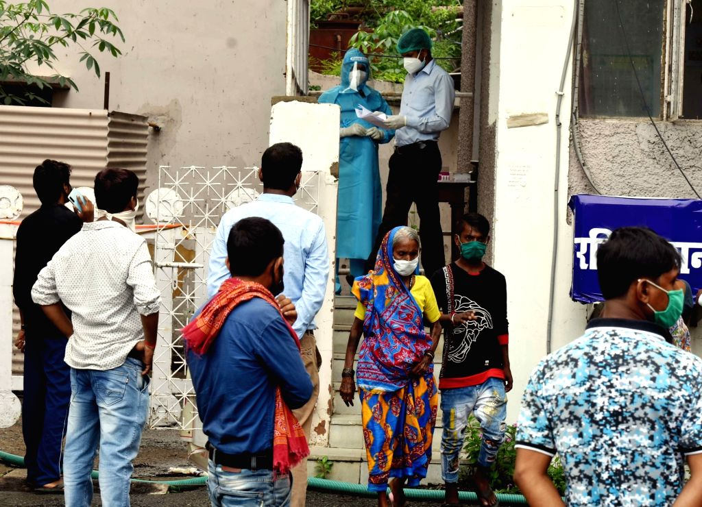 People gather to give their swab samples for coronavirus testing at Patliputra Ashok Hotel isolation centre, in Patna on Aug 12, 2020.