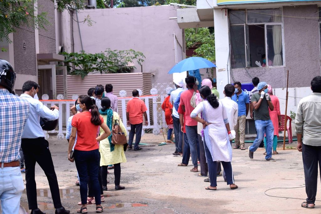 People gather to give their swab samples for coronavirus testing at Patliputra Ashok Hotel isolation centre, in Patna on Aug 14, 2020.