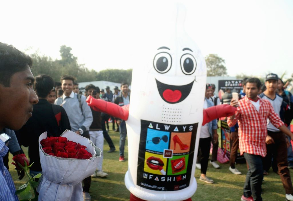 People gather to observer International Condom Day 2018 an event organised by Aids Healthcare Foundation in New Delhi on Feb 13, 2018.
