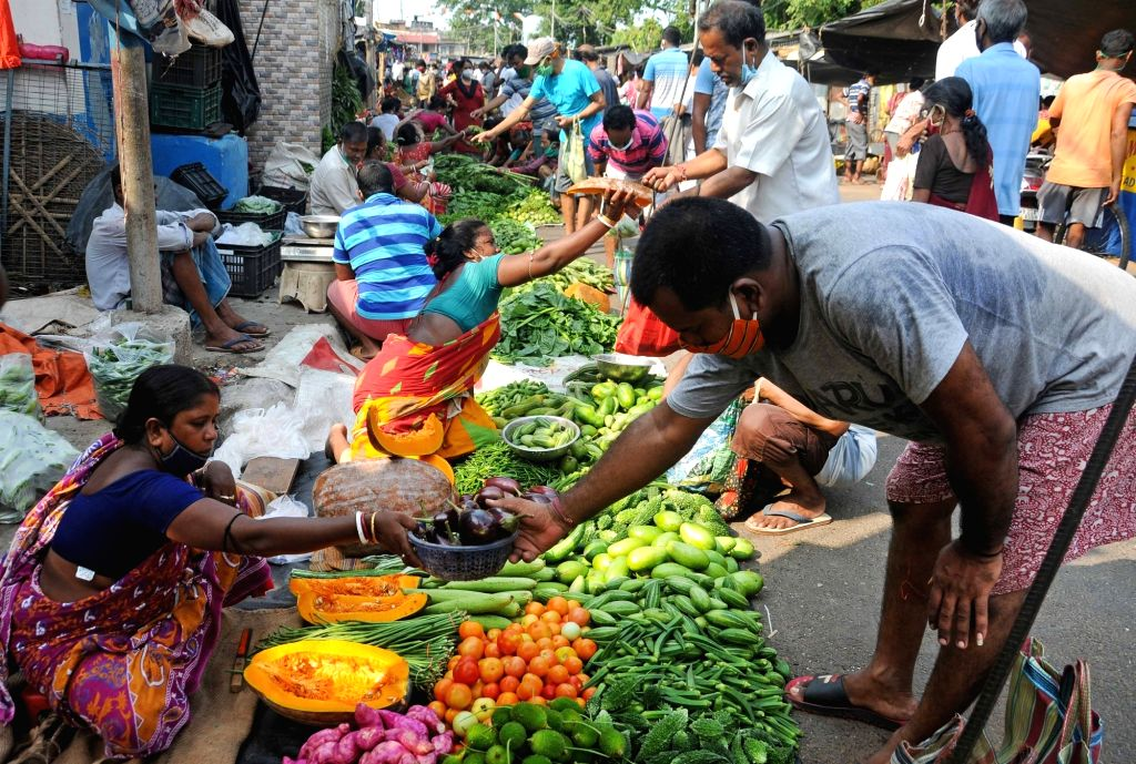 People gathered and neglected social distance at local vegetable market during lockdown on Coronavirus pandemic in Kolkata on Sunday, May 16, 2021.