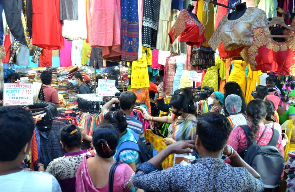 People gathered at market for shopping ahead of Durga Puja Festival in Kolkata on October 11, 2020,