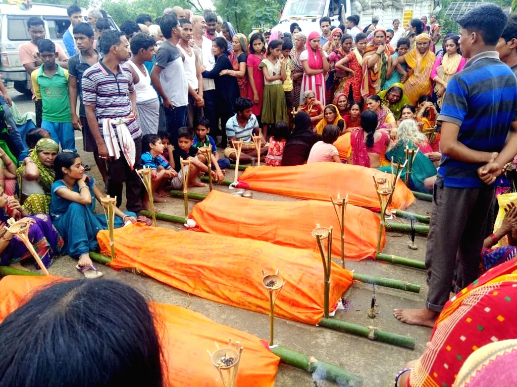 People gathers around 6 bodies killed on a car accident at NH333A in Jamui district, Bihar, on July 27, 2018.