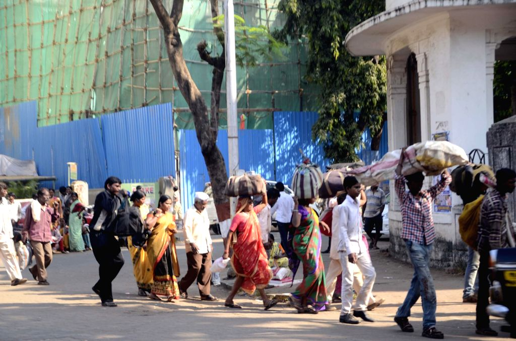 People going back home after attending the death anniversary of Dr. BR Ambedkar at Shivaji Park in Mumbai on Dec. 7, 2013.