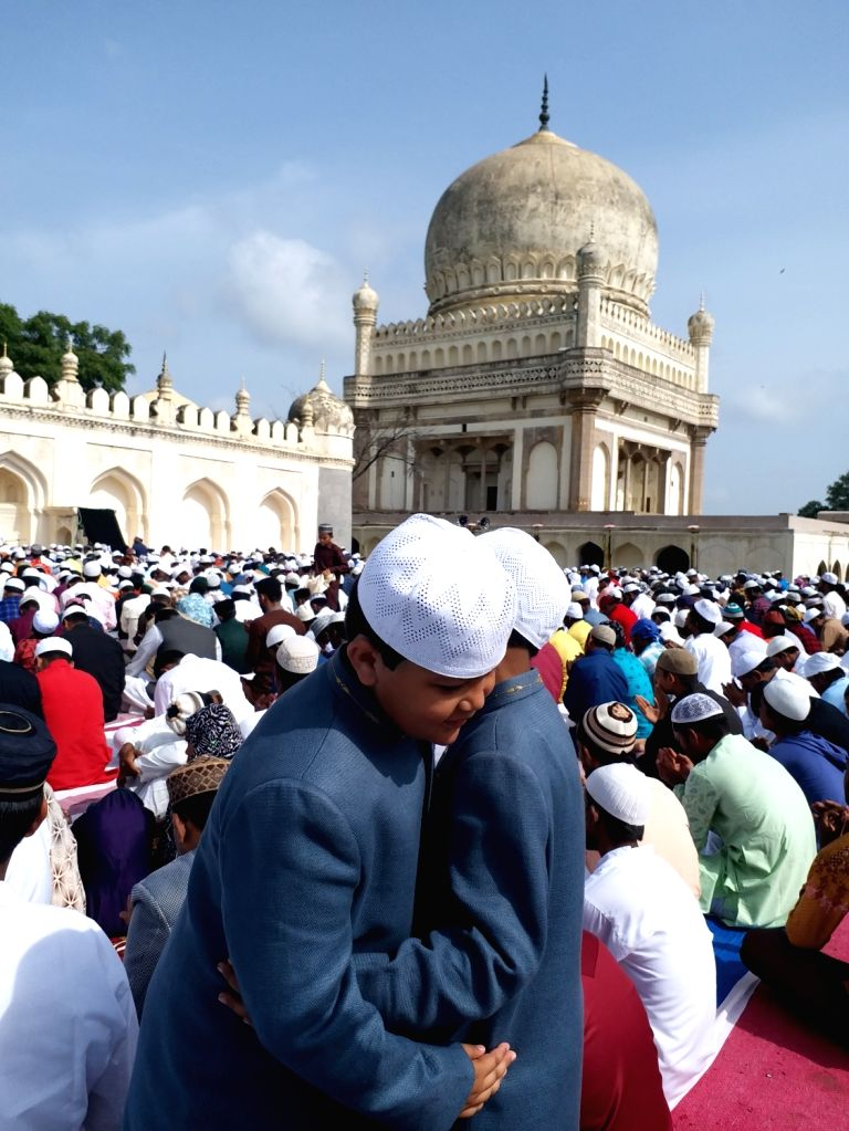 People greet each other on Eid-ul-Adha in Hyderabad on Aug 12, 2019.