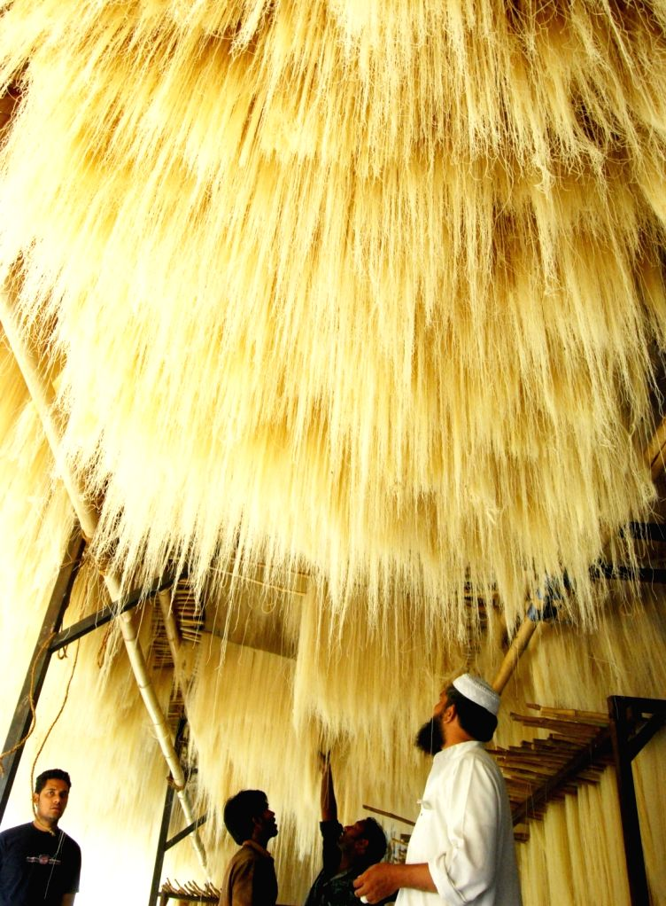 People hang Vermicelli for drying during Ramadan in Bhopal on June 16, 2016.