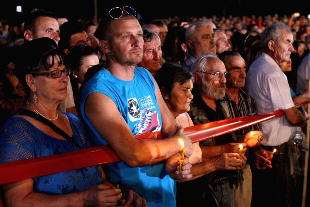 """People hold candles on the bank of the Sava River in honor of the victims of the 1995 Croatian """"Operation Storm"""" near the town of Sremska Raca, ..."""