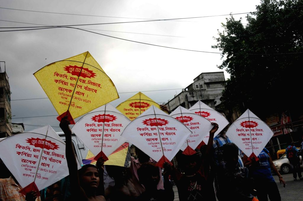 People holding kites participate in an organ donation awareness rally on the eve of Vishwakarma Puja in Kolkata, on Sept 16, 2016. People fly kites to celebrate Vishwakarma Puja in West ...