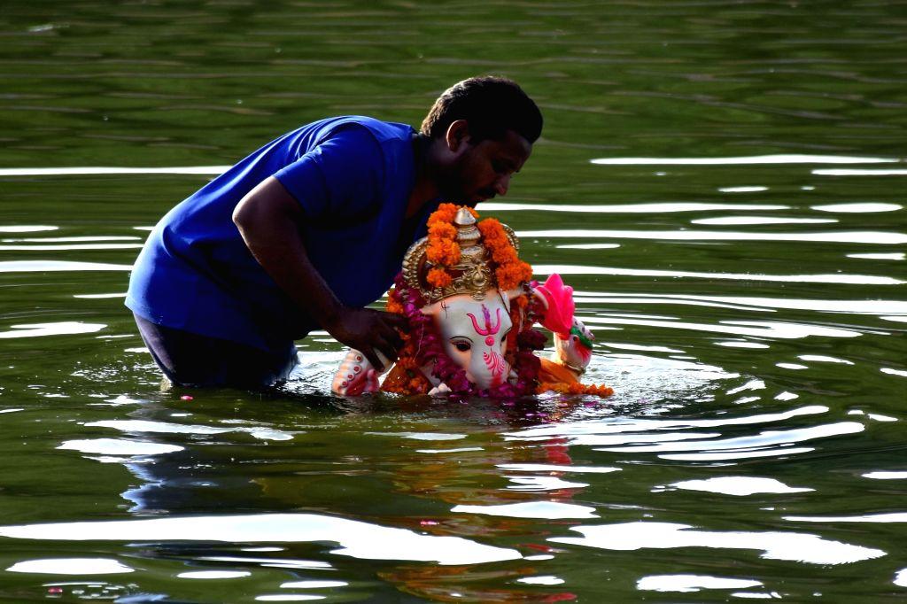 People immerse Ganesha idols in Maota Lake of Jaipur on Sept 9, 2016.