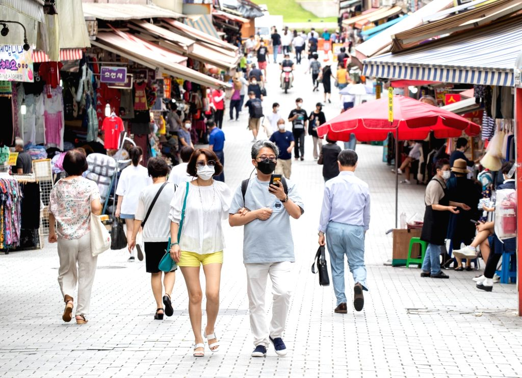 People in face masks walk at Namdaemun Market in Seoul, South Korea, Sept. 1, 2020. South Korea reported 235 more cases of the COVID-19 as of 0:00 a.m. Tuesday local ...