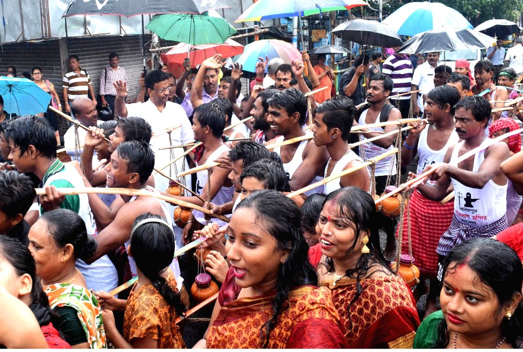 People in large numbers arrive to offer Ganga water and milk to Lord Shiva at the Bhukailash temple during Shrabani festival in Kolkata on July 31, 2017.