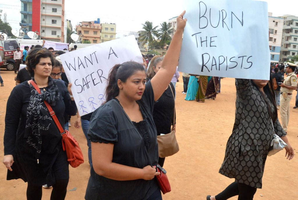 People in large numbers demonstrate against alleged rape of a 6-year-old student in Bangalore on July 17, 2014.