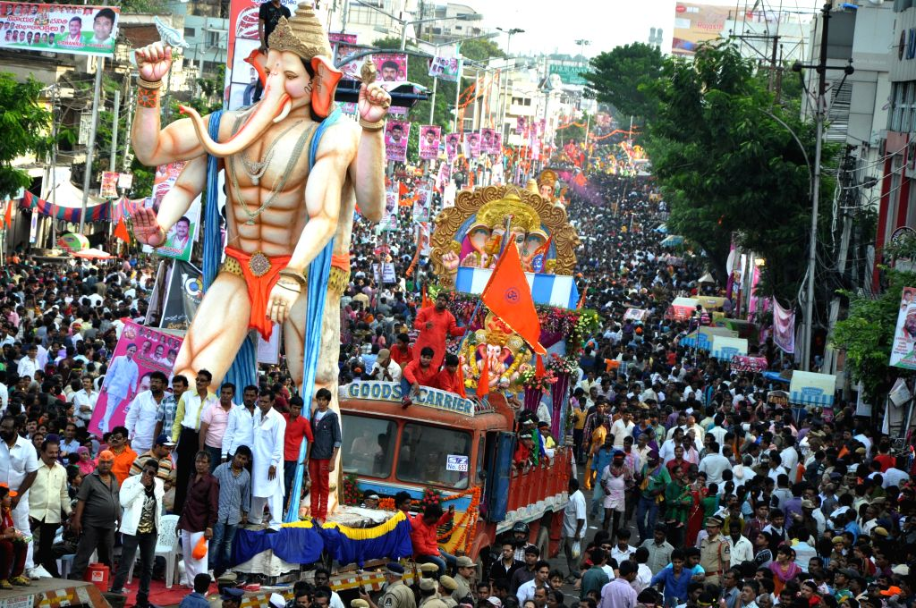 People in large numbers participate in a Ganesh idol immersion procession after Ganesh Festival in Hyderabad on Sept 8, 2014.