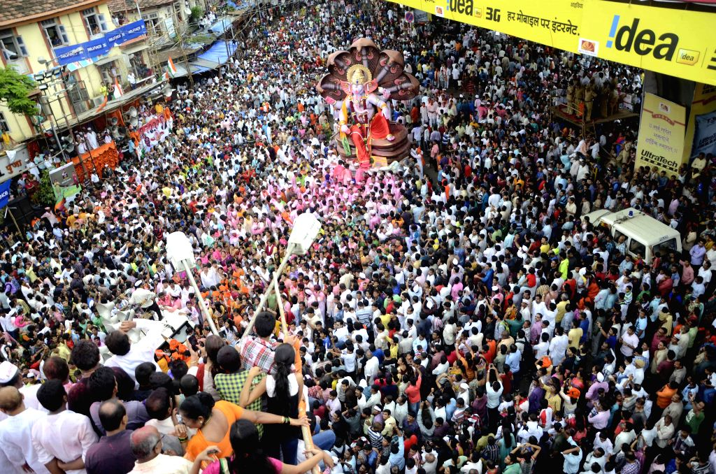 People in large numbers participate in a Ganesh idol immersion procession in Mumbai on Sept 8, 2014.