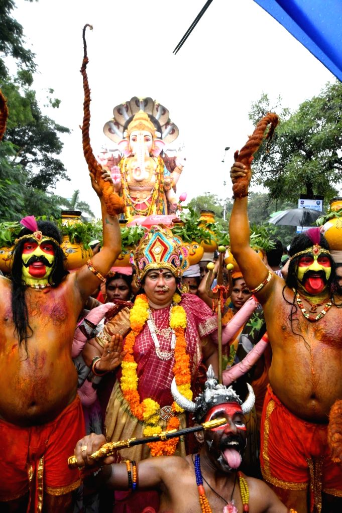 People in large numbers participate in Ganesha idol immersions at Hussain Sagar lake in Hyderabad on Sept 15, 2016.