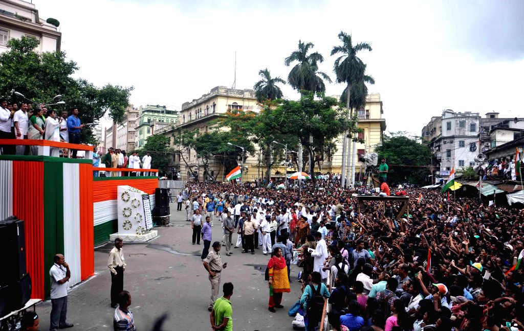 People in large numbers participate in Martyr's day (Shaheed Diwas) celebrations in Kolkata on July 21, 2014. Martyr's day is celebrated by Trinamool Congress  every year on 21st July.