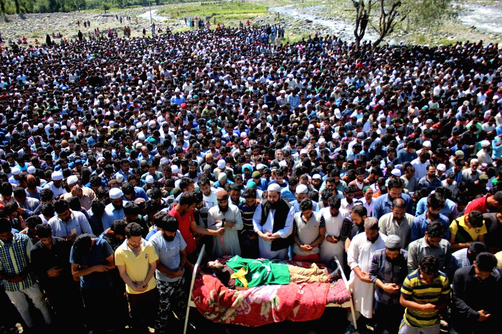 People in large numbers participate in the funeral of militant commander Bashir Lashkari at his ancestral graveyard in Jammu and Kashmir's Anantnag district on July 2, 2017. The LeT ...