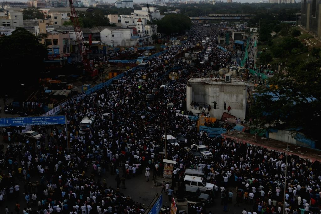 People in large numbers participate in the funeral procession of DMK patriarch and former Tamil Nadu Chief Minister M. Karunanidhi, in Chennai on Aug 8, 2018. Karunanidhi was buried beside ... - M. Karunanidhi
