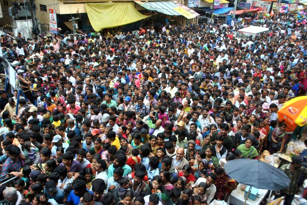 People in large numbers participate in the Ganesh idol immersion procession after Ganesh Festival in Hyderabad on Sept 8, 2014.