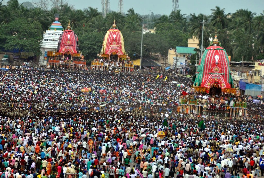 People in large numbers pull the chariots of lord Jagannath, Balabhadra and Subhadra during Ulta Rath Yatra -Return Journey- in Puri of Odisha on July 14, 2016.