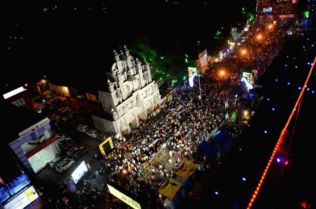 People in large numbers visit Dak Bunglow Durga Puja pandal in Patna, on Oct 20, 2015.