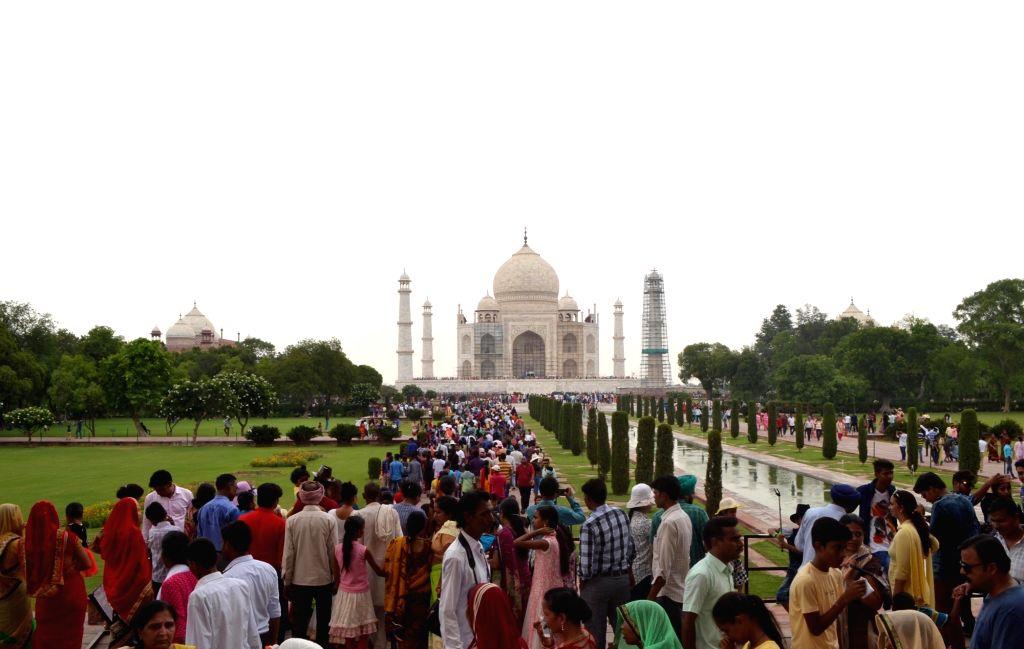 People in large numbers visit the Taj Mahal in Agra on June 25, 2017.