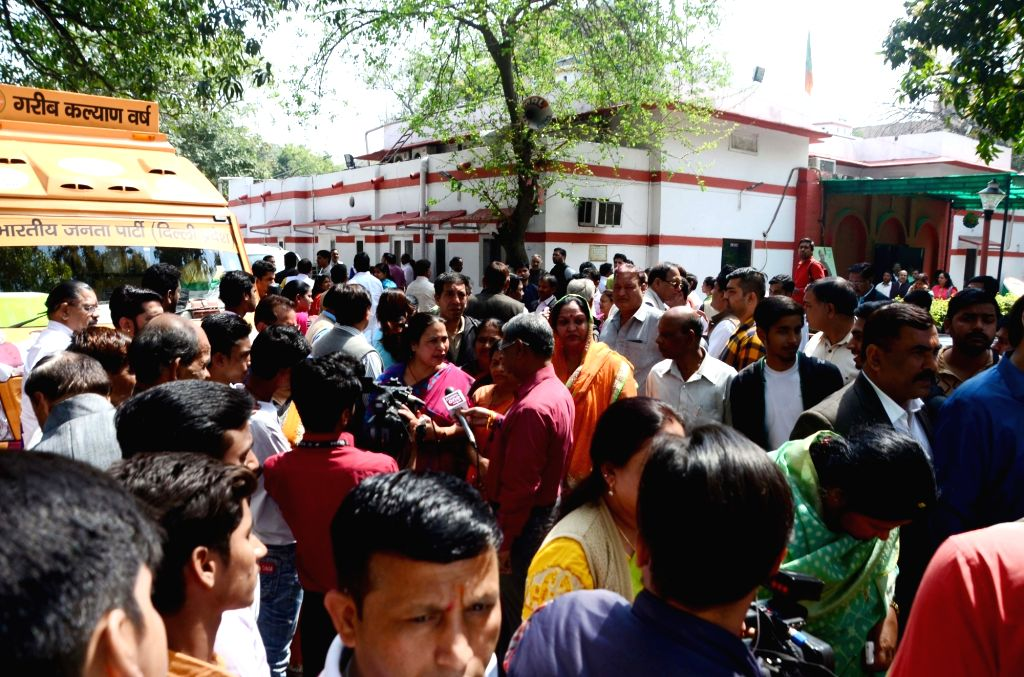 People in large numbers wait outside the BJP Delhi Office during counselor meeting for MCD polls counselor ticket issue; in New Delhi on March 14, 2017.