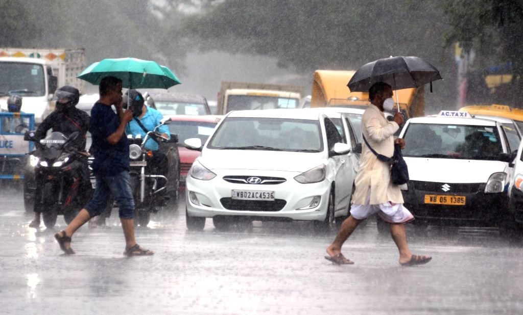 People in the rain on the street for various workers on the ongoing lockdown during the coronavirus pandemic in Kolkata on Wednesday, June 23, 2021.