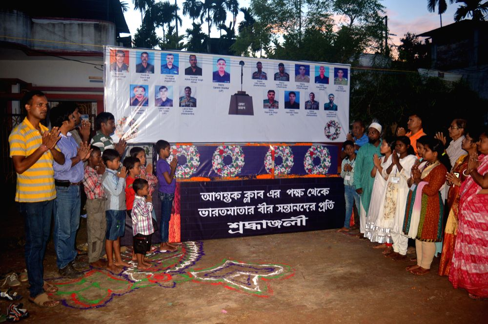 People including kids paying their tribute to the Uri martyrs. Photo : Jakir Hossain