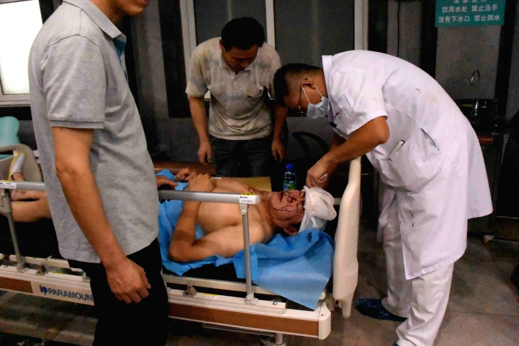 People injured in an explosion in the Binhai New Area receives treatment in a hospital in north China's Tianjin Municipality, Aug. 13, 2015. The death toll from a ...