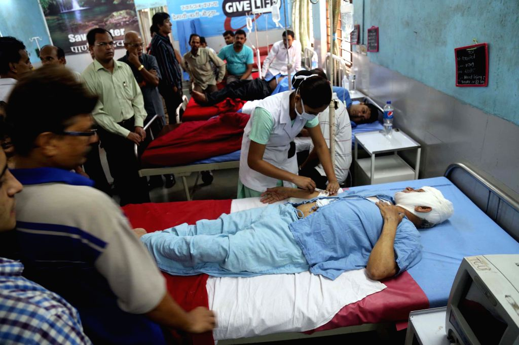 People injured in Thane building collapsed being treated at a hospital on Aug 4, 2015. Atleast 11 persons died and five people have been rescued, six more are feared trapped under the debris ...