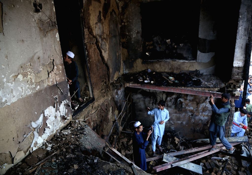 :People inspect a damaged room after a suicide attack in Kabul, capital of Afghanistan, July 26, 2018. At least one Afghan civilian and four intelligence officers ...
