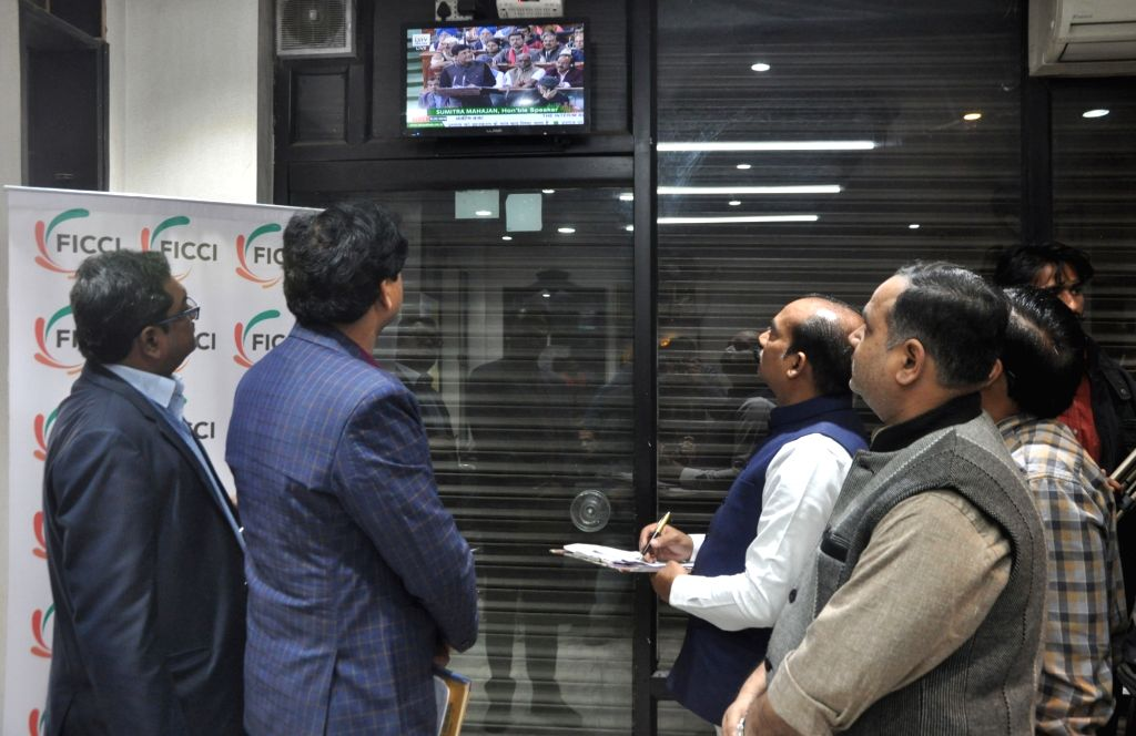People keep a close eye as Union Finance Minister Piyush Goyal presents the interim budget 2019 at FICCI in Lucknow, on Feb 1, 2019. - Piyush Goyal