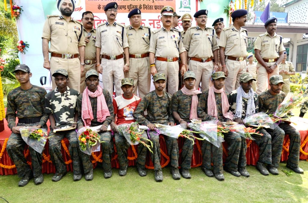 People Liberation Front of India (PLFI) Naxal group Sub-Zonal Commander Lal Bihari Singh alongwith nine other naxals surrender before Jharkhand DGP Police DK Pandey during 'Operation Nayi ...