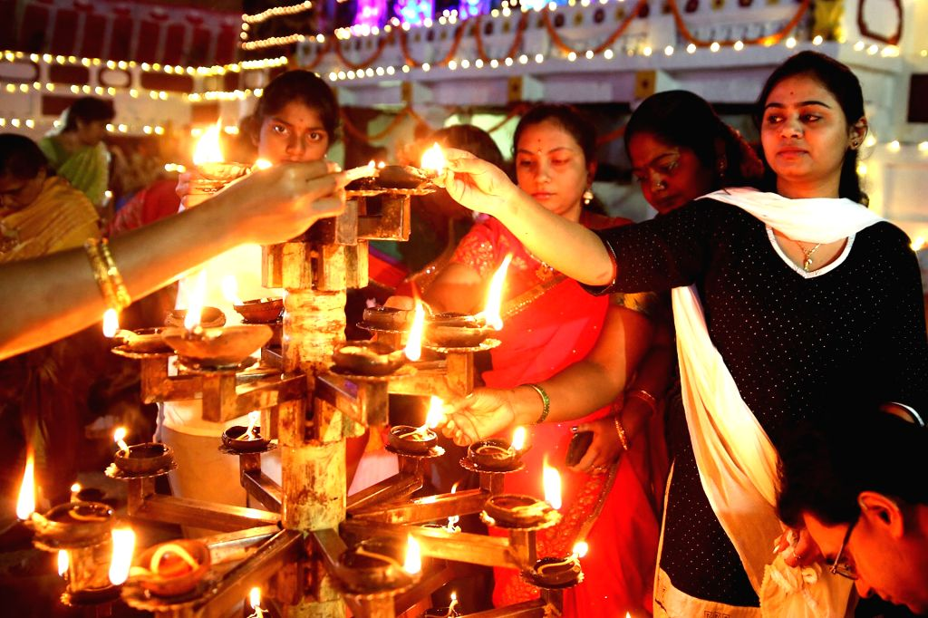 People light lamps on Laksha Deepotsava in Bengaluru on Dec 3, 2018.