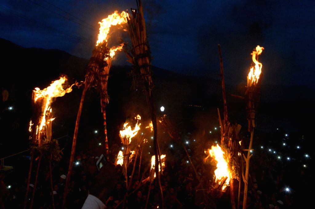 People light torches at the shrine of Hazrat Zain-u- Din Wali (RA) during annual urs at Aishmuqam of Jammu and Kashmir's Anantnag district on April 21, 2016.