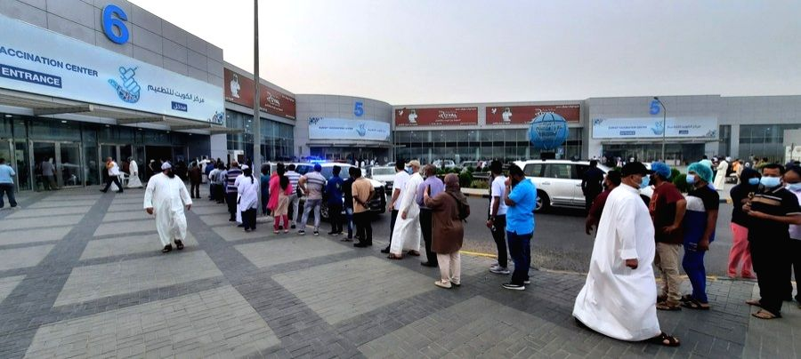 People line up to receive COVID-19 jab at a vaccination site in the Hawalli Governorate, Kuwait, June 14, 2021. (Photo by Asad/Xinhua)