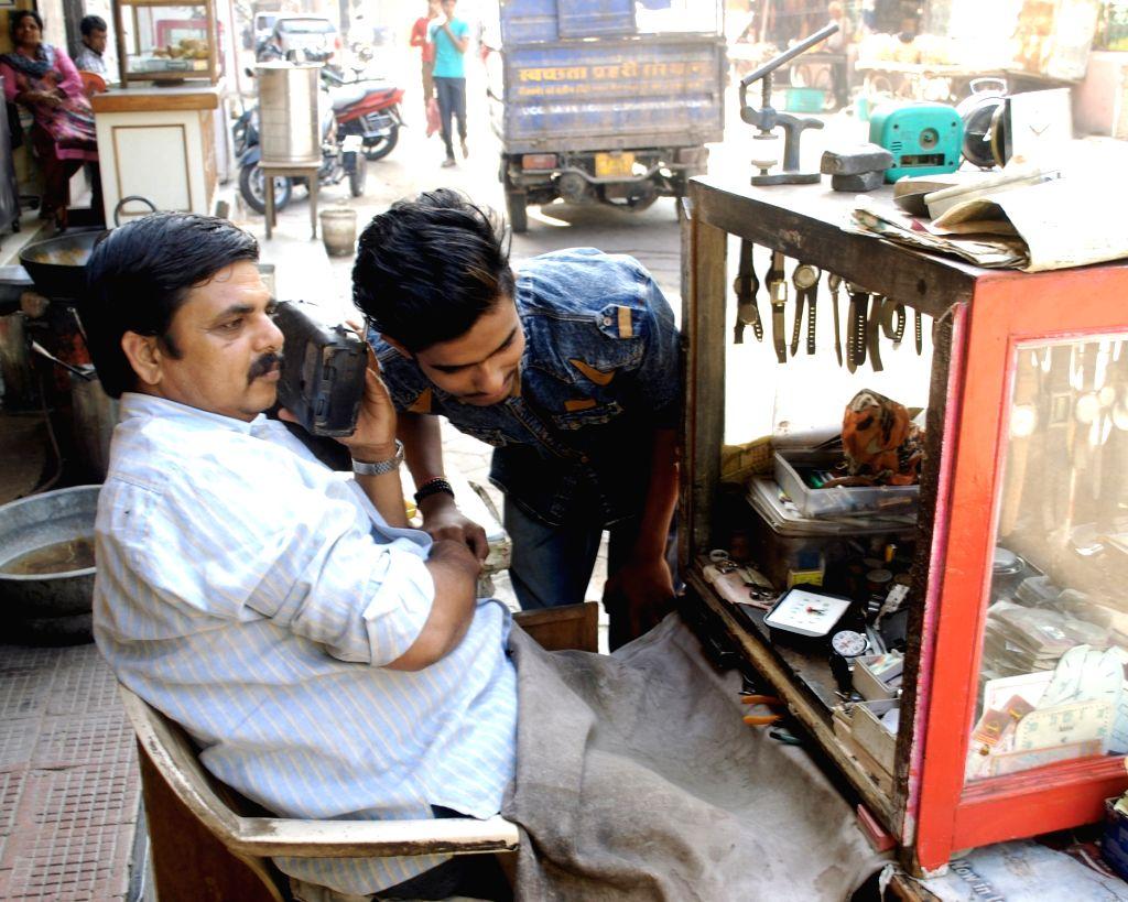 """People listening to Prime Minister Narendra Modi's """"Mann Ki Baat"""". (File Photo: IANS) - Narendra Modi"""