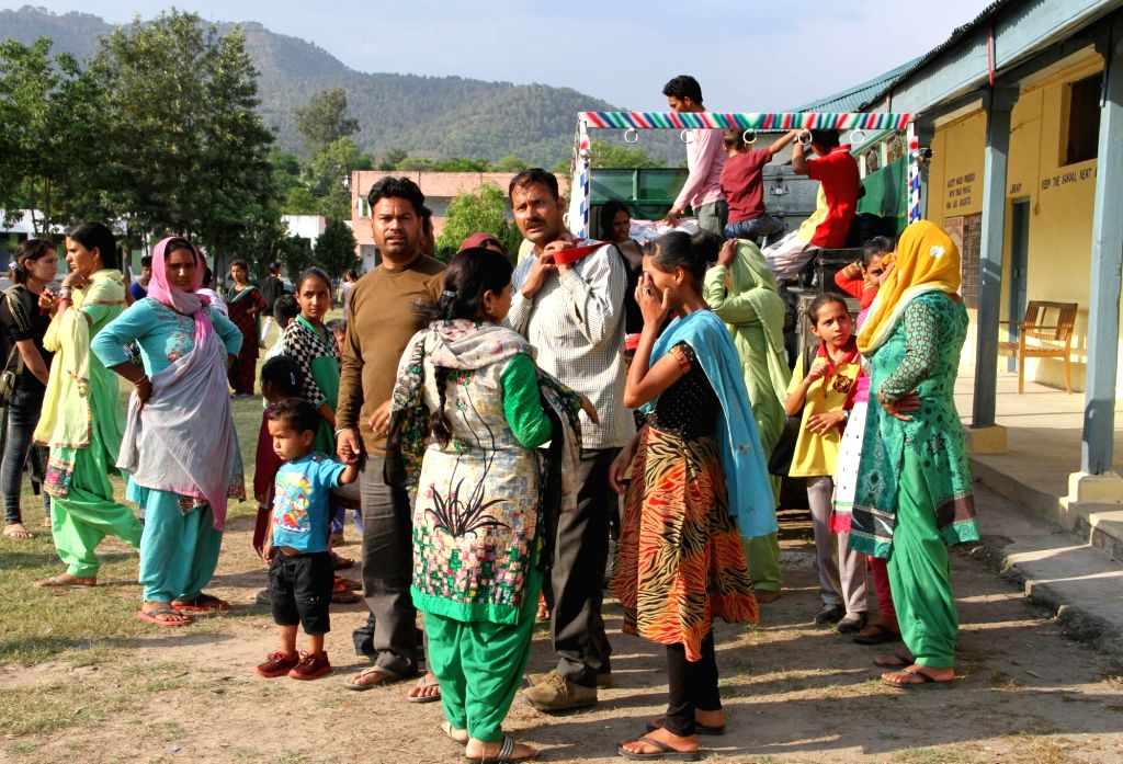 People living in border areas of Jammu and Kashmir migrate to safer places after cross border firing started in Nowshera sector of the LoC on May 14, 2017.
