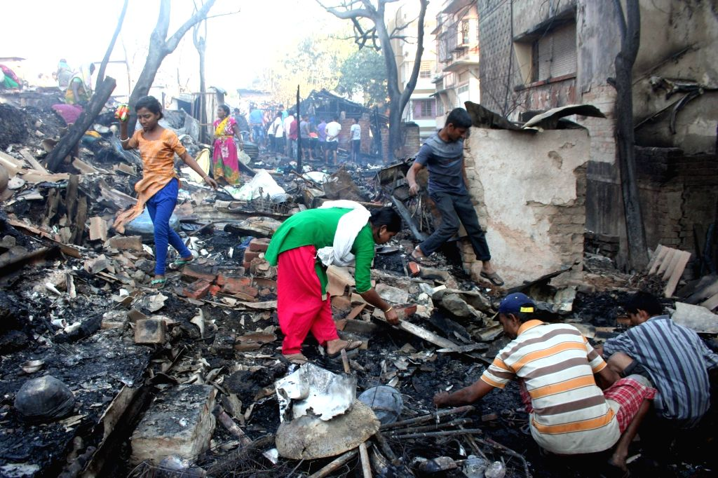 People look for their belongings after their houses were gutted in a fire that broke out in Dunlop, Kolkata on Feb 12, 2019.