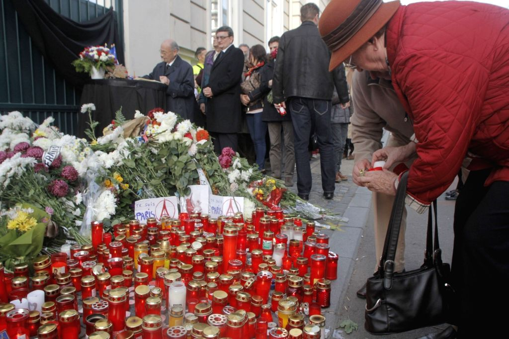 People mourn for victims of Paris terror attacks in front of the French Embassy in Bucharest, Romania, on Nov. 15, 2015.