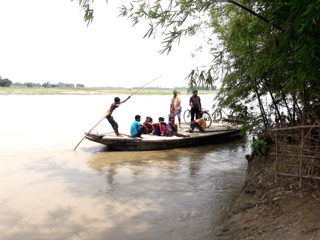 People move to higher lands as flood hits Bihar's Kishanganj district on July 6, 2018.