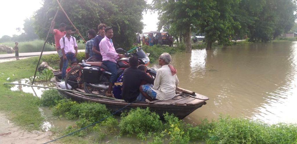 People move to higher place in the flood-hit Katihar of Bihar, on July 17, 2019.