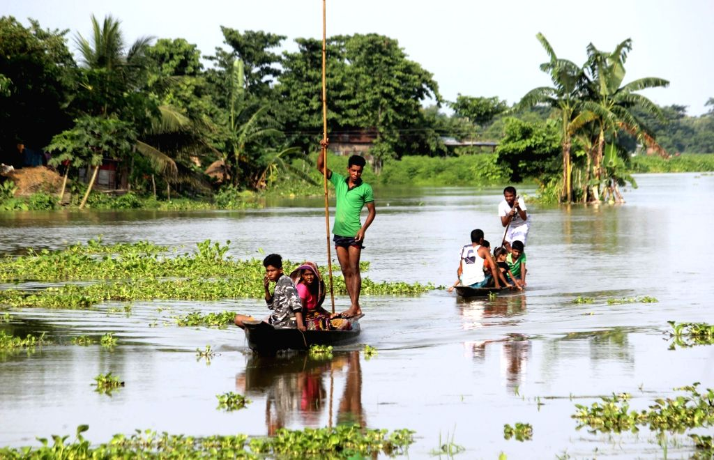 People move to higher placees in flood hit Hajo, Assam on July 16, 2019.