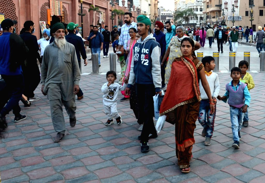 People not wearing face masks, at the Heritage street near the golden temple in Amritsar on Tuesday, Feb. 23, 2021.
