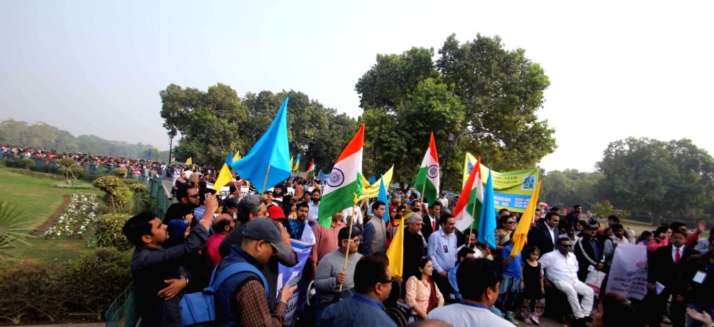 People observe World Disability Day at India Gate in New Delhi on Dec 3, 2015.