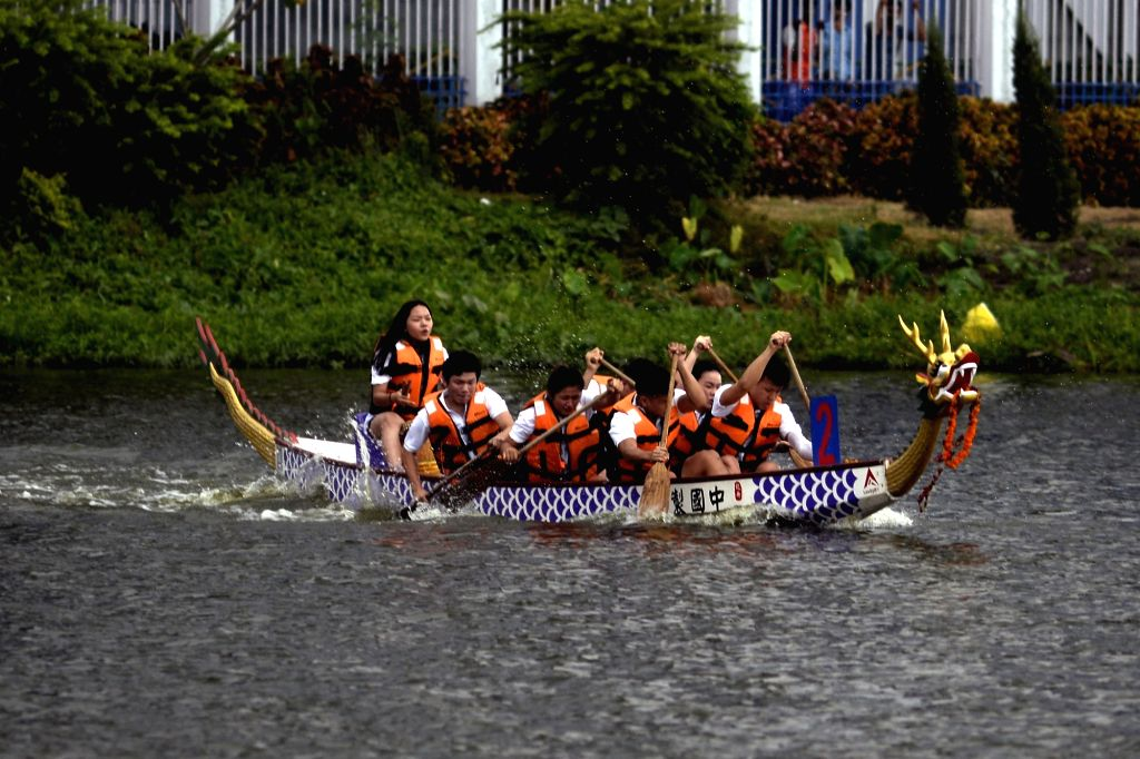 People of Chinese origin enjoys sailing a boat ahead of the Dragon Boat Festival 2019,  in Kolkata, on June 2, 2019.